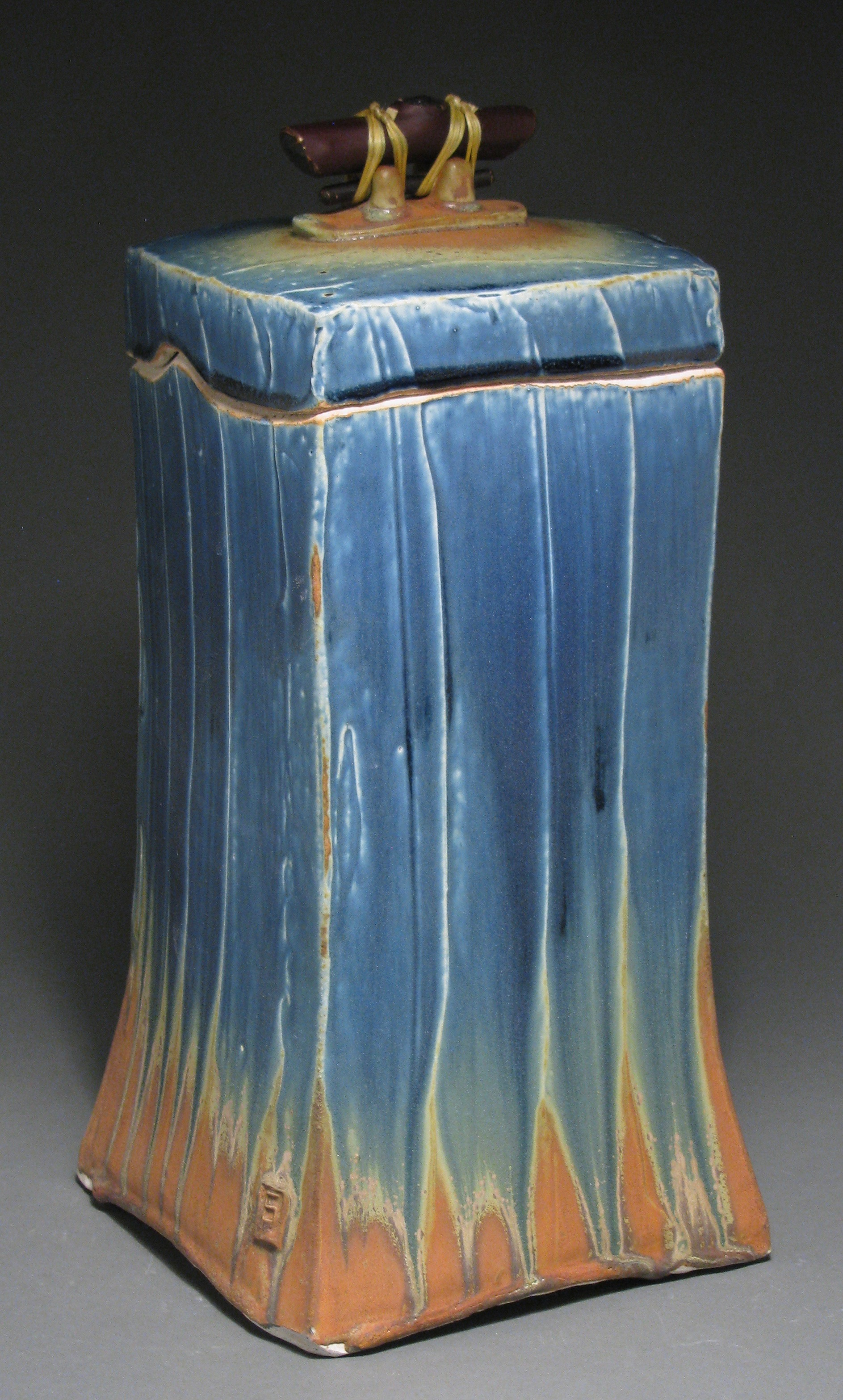 """Lidded box or funerary urn  13 1/4"""" tall by 6 1/4"""" deep by 6 1/4"""" wide  Glazes: Mixed blue and matte rust"""