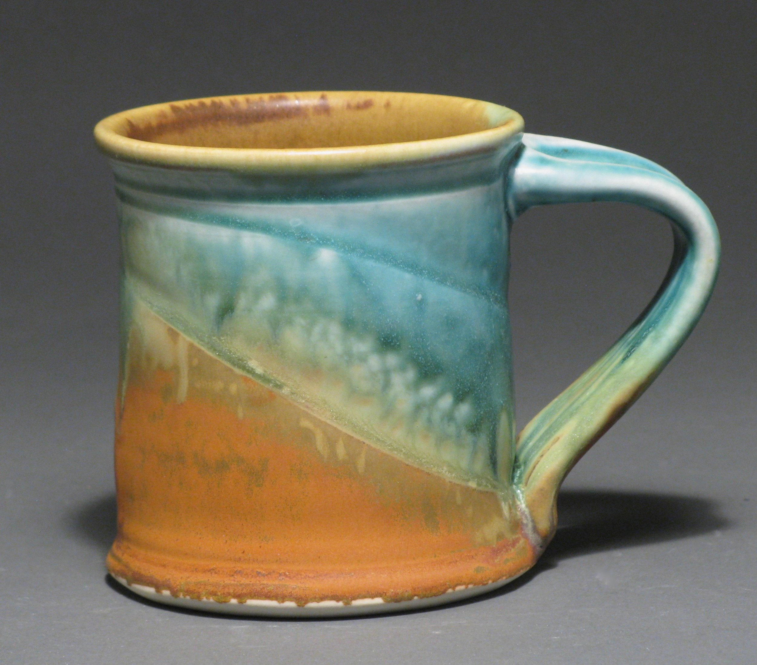 "Cylindrical mug  4"" tall  Glazes: Matte turquoise and matte rust"