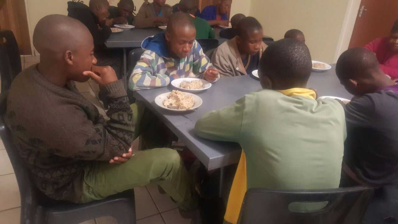 Kids and families at Motsekuoa eating our meals.