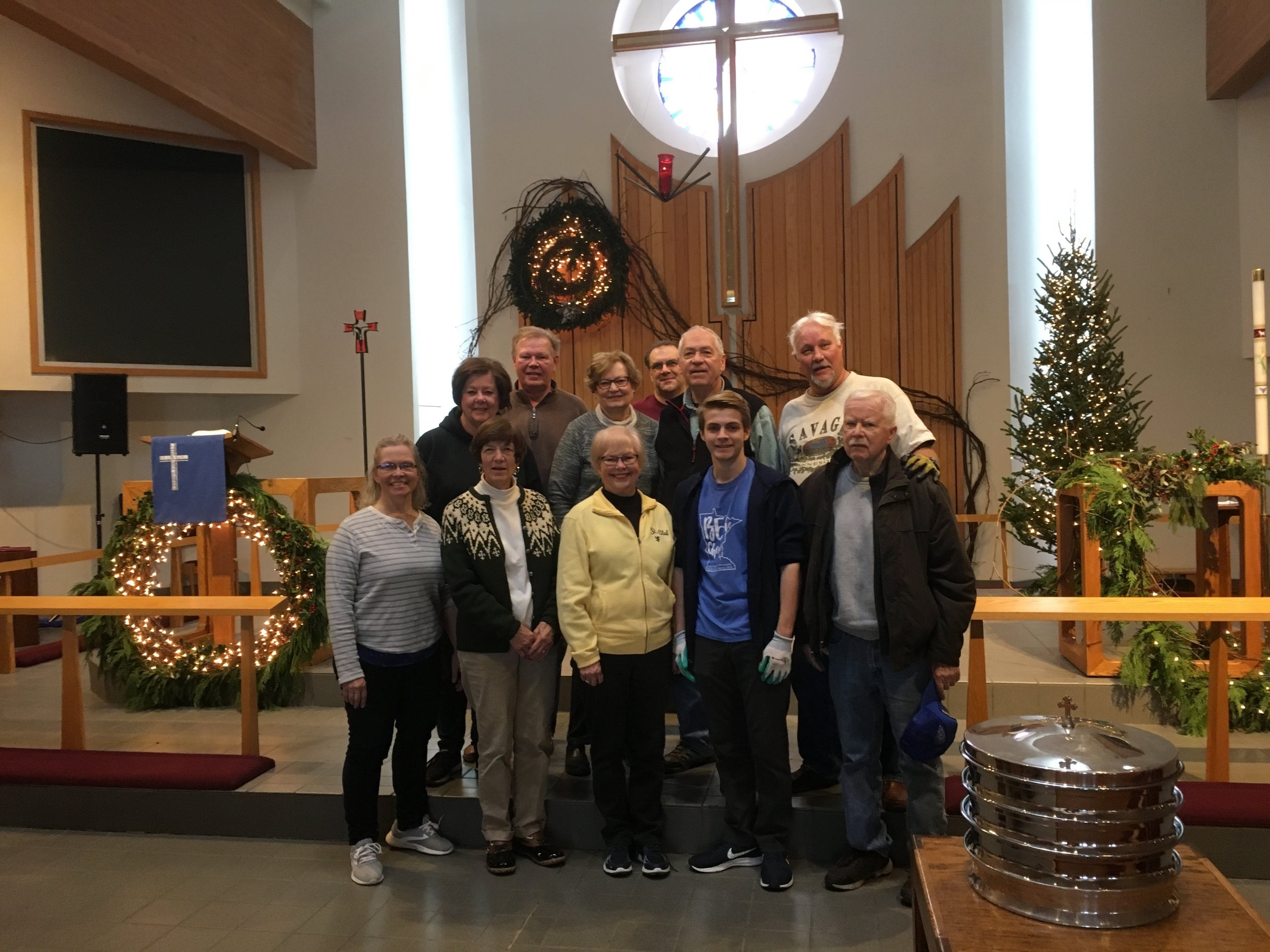 A dedicated group of folks decorates the Sanctuary for Advent and Christmas celebrations.  Led by Kelvin Miller, Minister of Music, this crew brings joy to their task.