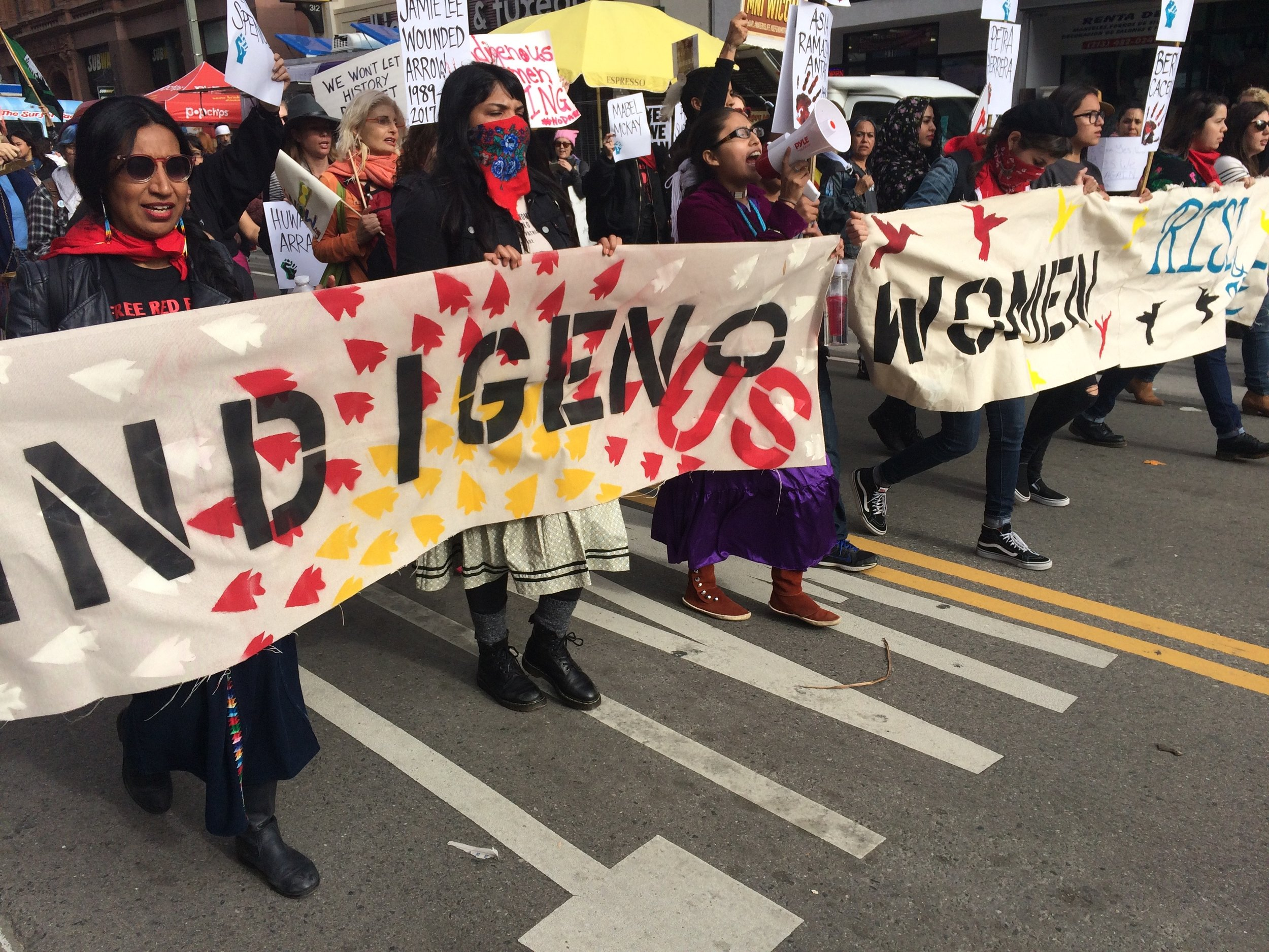 Indigenous Women Rise, one of many groups showing support for the day, carried banners down Broadway. (Photo by Loud Owl)