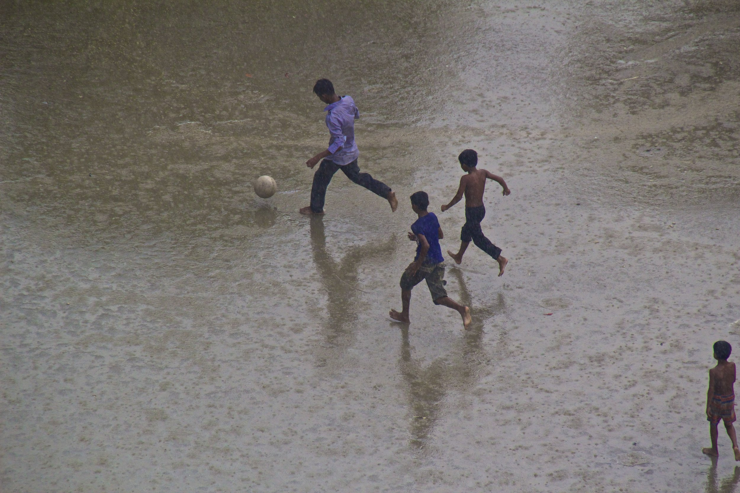dhaka bangladesh slums soccer monsoon rain 7.jpg