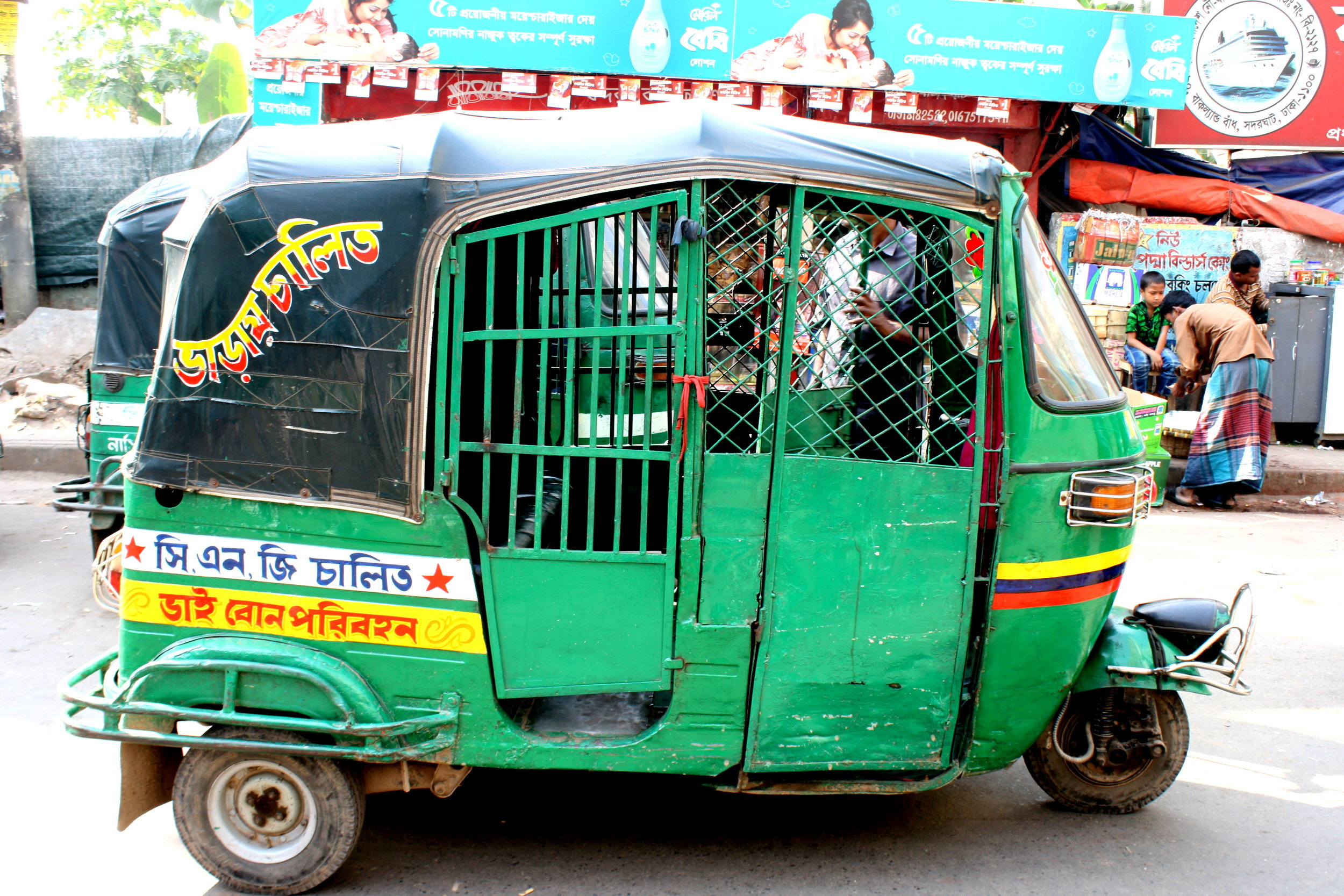 Credit: https://beardedvagabond.wordpress.com/2013/01/10/dhaka-the-heart-of-madness/baby-taxi-cng-dhaka/