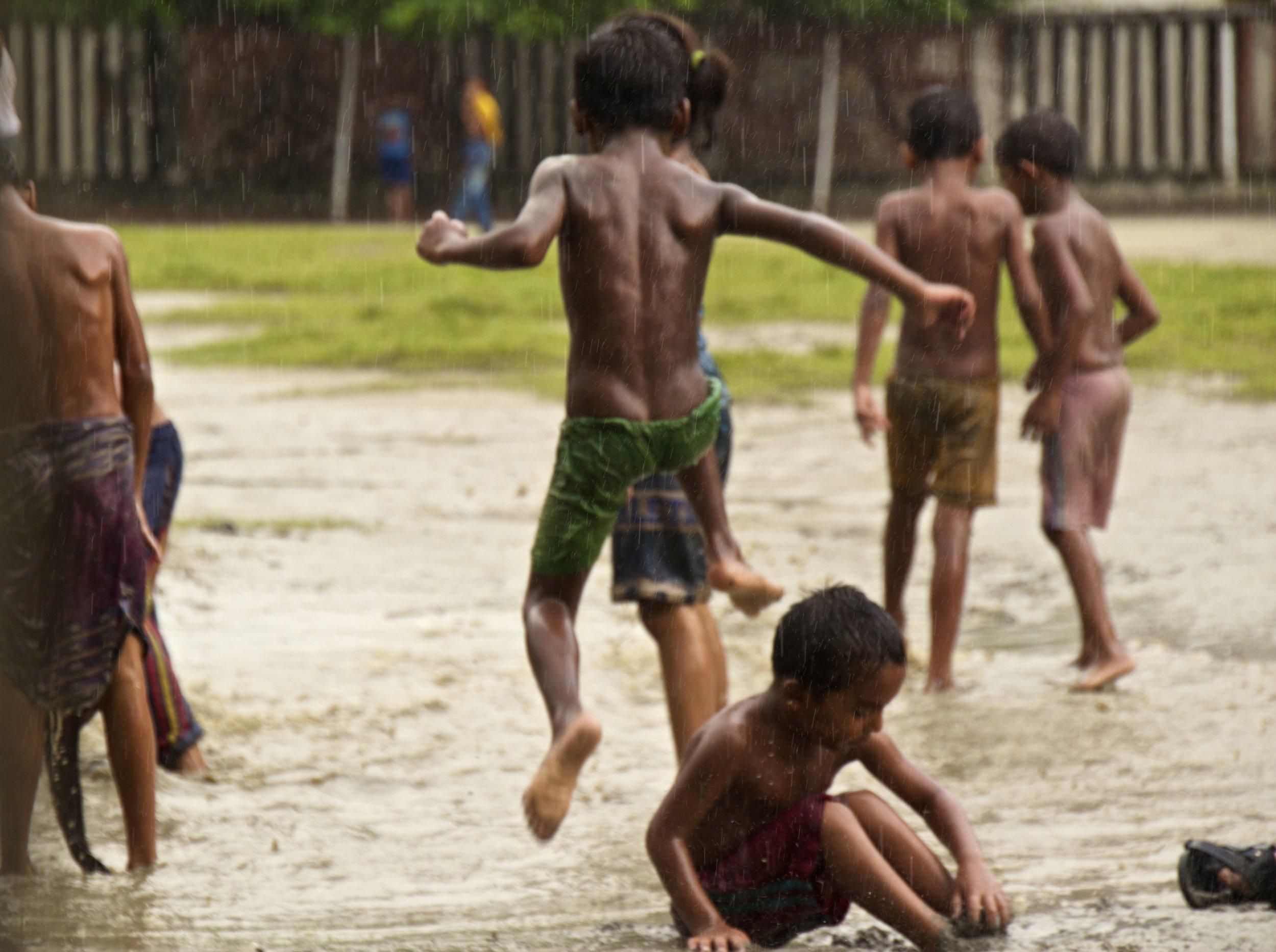 dhaka bangladesh children play in the rain 4.jpg