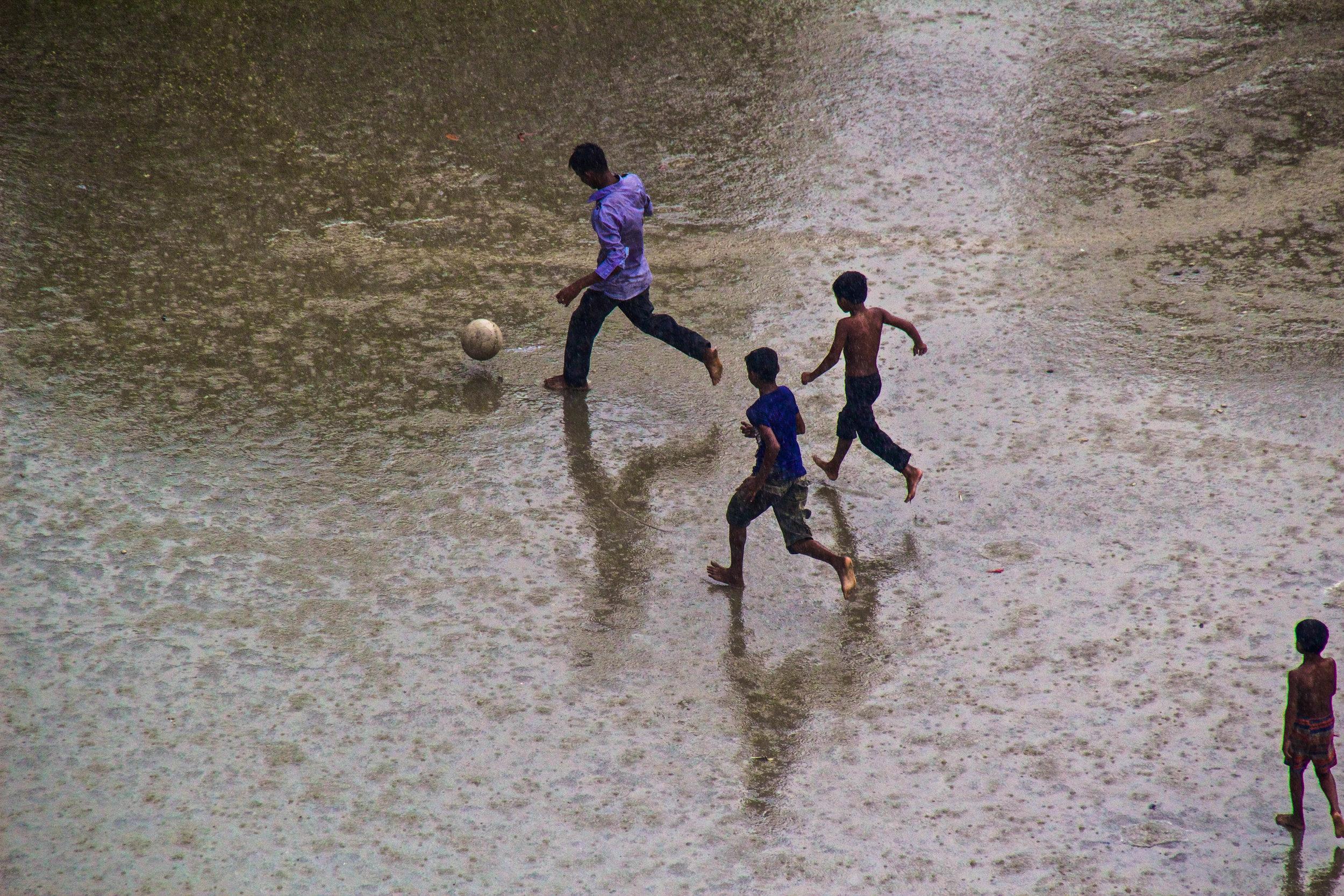 dhaka bangladesh slums soccer monsoon rain 7-2.jpg