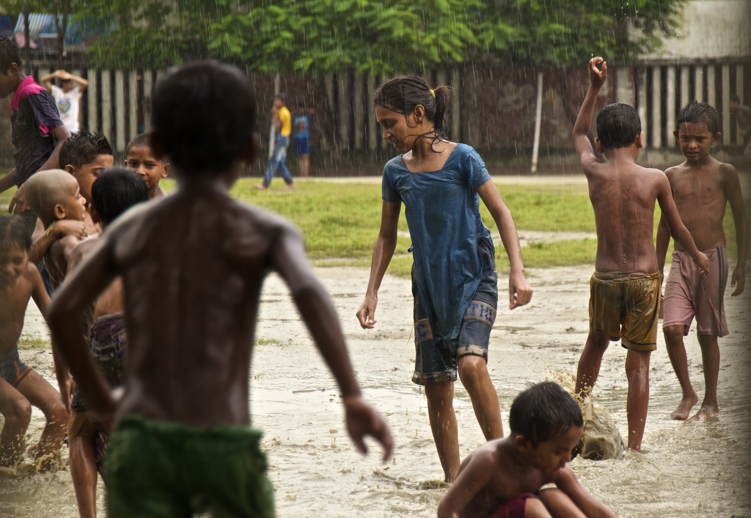 dhaka bangladesh children play in the rain 3.jpg