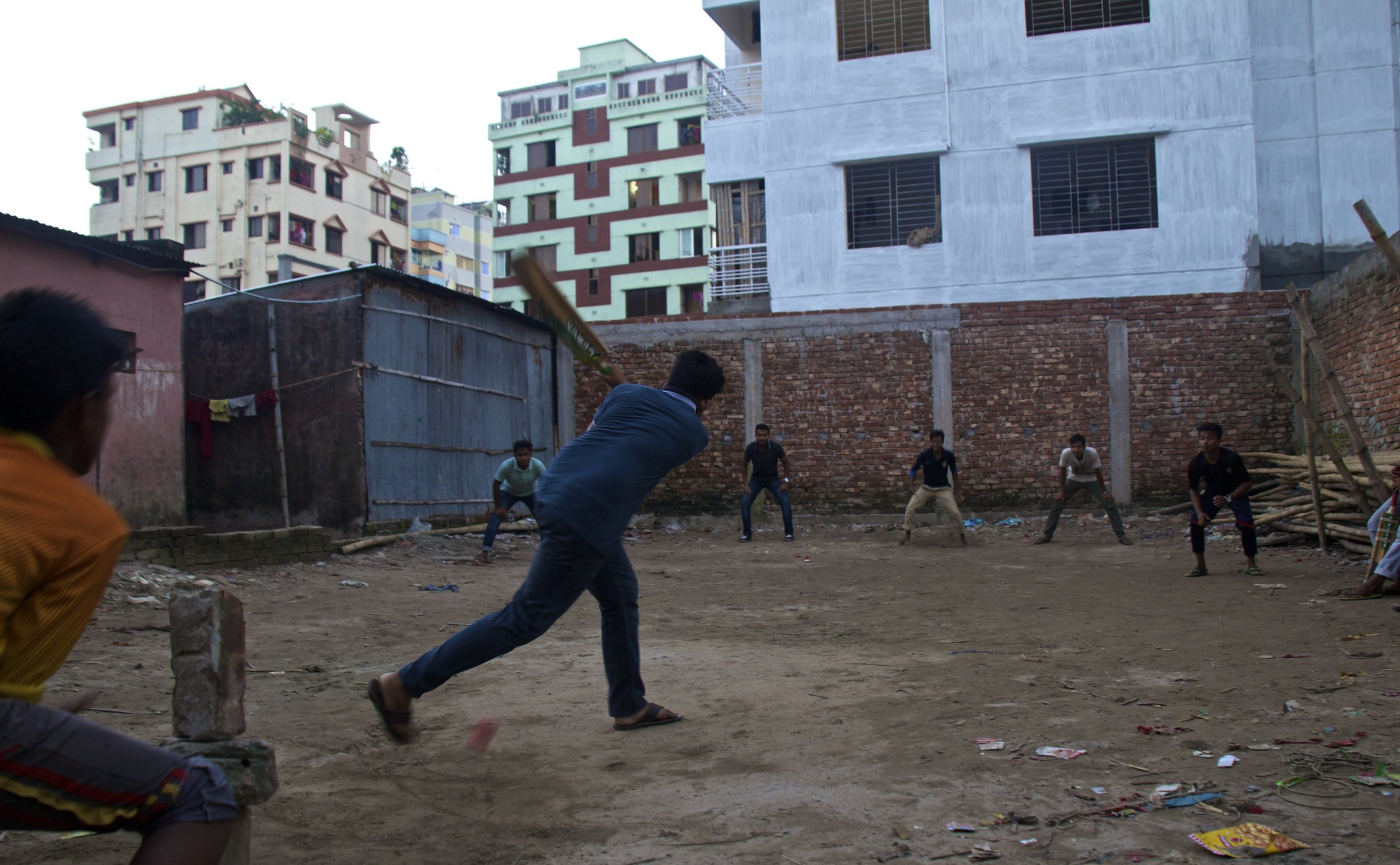 rayer bazar dhaka slums playing cricket 5.jpg