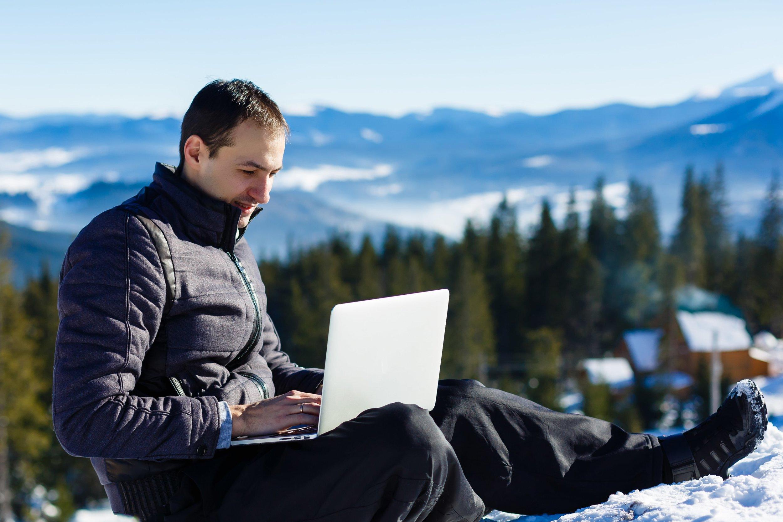 5-bookkeeping-tips-business-man-on-mountain.jpeg