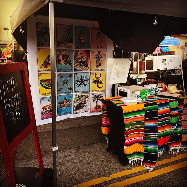 Our booth at last weeks @wilmingtonartwalk event with our new #lotería backdrop!