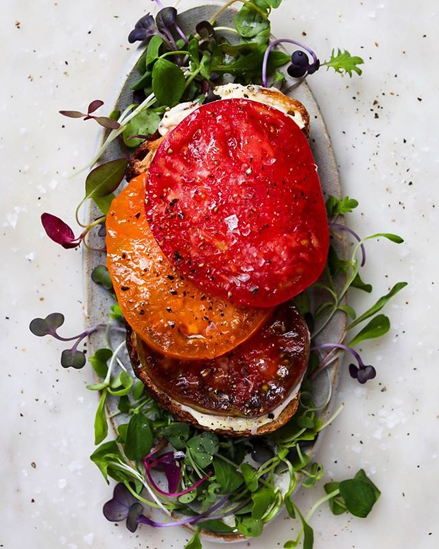 This is happening daily. But, I think you knew that. Heirloom tomatoes, micro greens, toasted sourdough, flaky sea salt, fresh ground pepper and a generous swipe of mayo.  #f52seasonal #tomato #tomatosandwich #heirloomtomato #howisummer