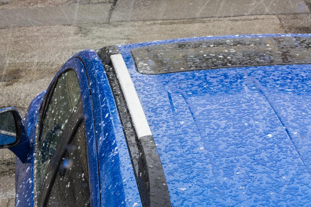 stock-photo-hail-falls-on-a-blue-car-roof-457304704.jpg
