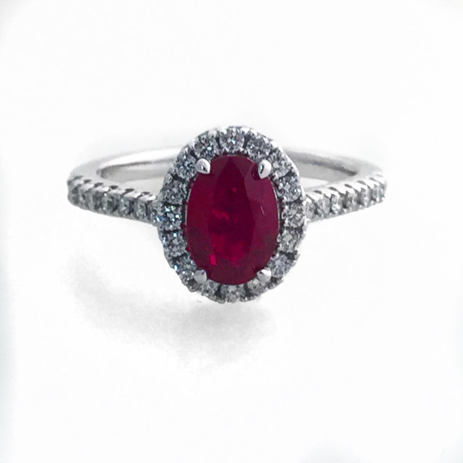 Platinum Halo Diamond ring with Ruby Center.  Available with any precious or semi precious stone.