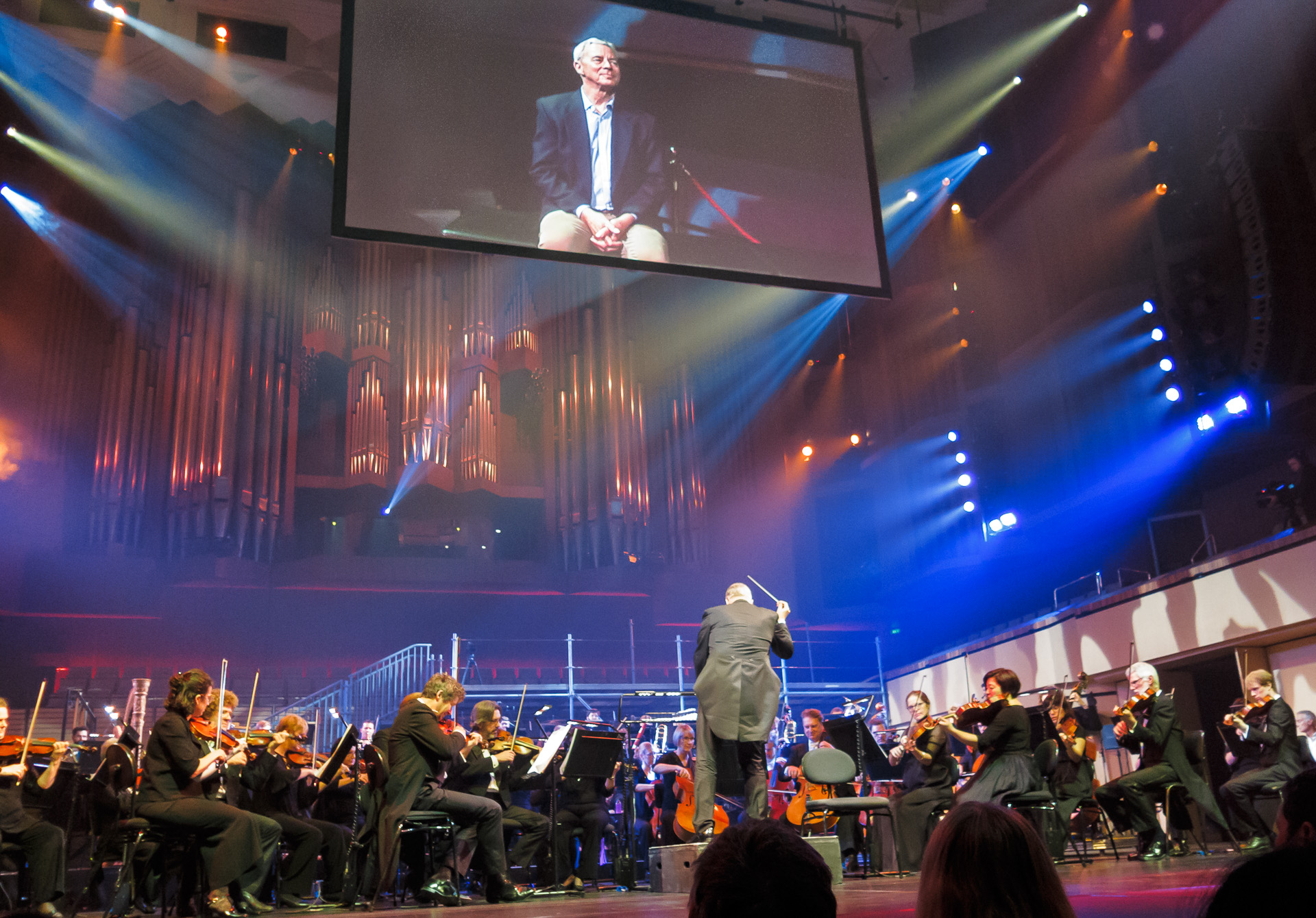 Pictured: Karl (on the big screen), listening to the fourth movement from  Tchaikovsky 's  Symphony No.7  (completed by Semyon Bogatyrev).  Picture credit: Creative Futures Photography.