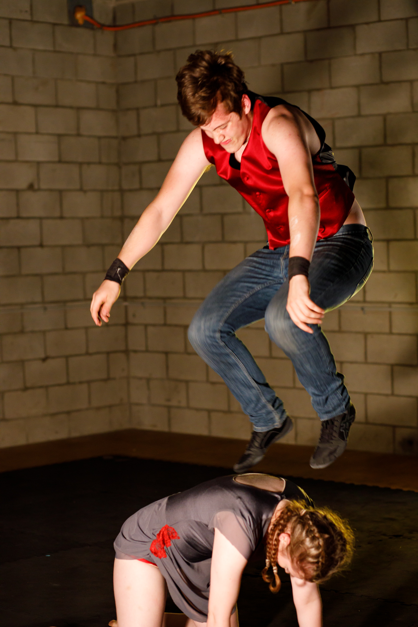 Pictured: Fin Casey jumping onto Megan Casey's back in   Inertia: The First Law   .  Picture credit:  Creative Futures Photography .