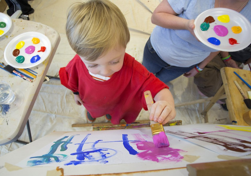 Evan Bonner, 3, works on a painting at USA Children's & Women's Hospital Wednesday, Sept. 25, 2013, as part of the Gifted Masterpieces program.