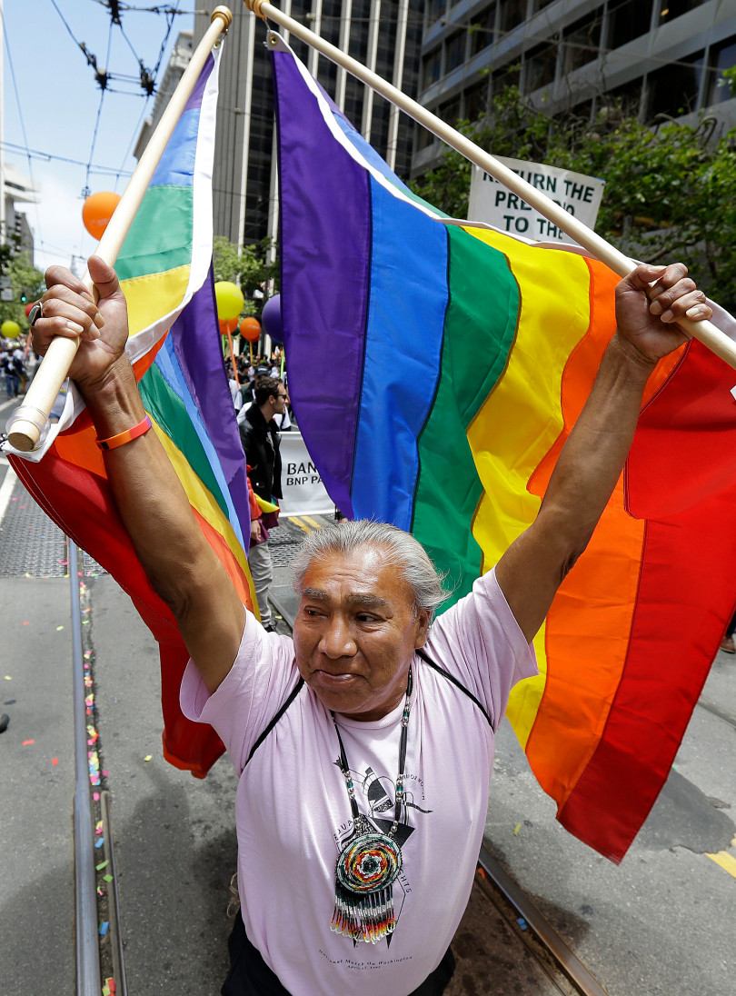 Randy Burns, co-founder of Gay American Indians, walks during the Pride parade in San Francisco, Sunday, June 25, 2017 By Chiu