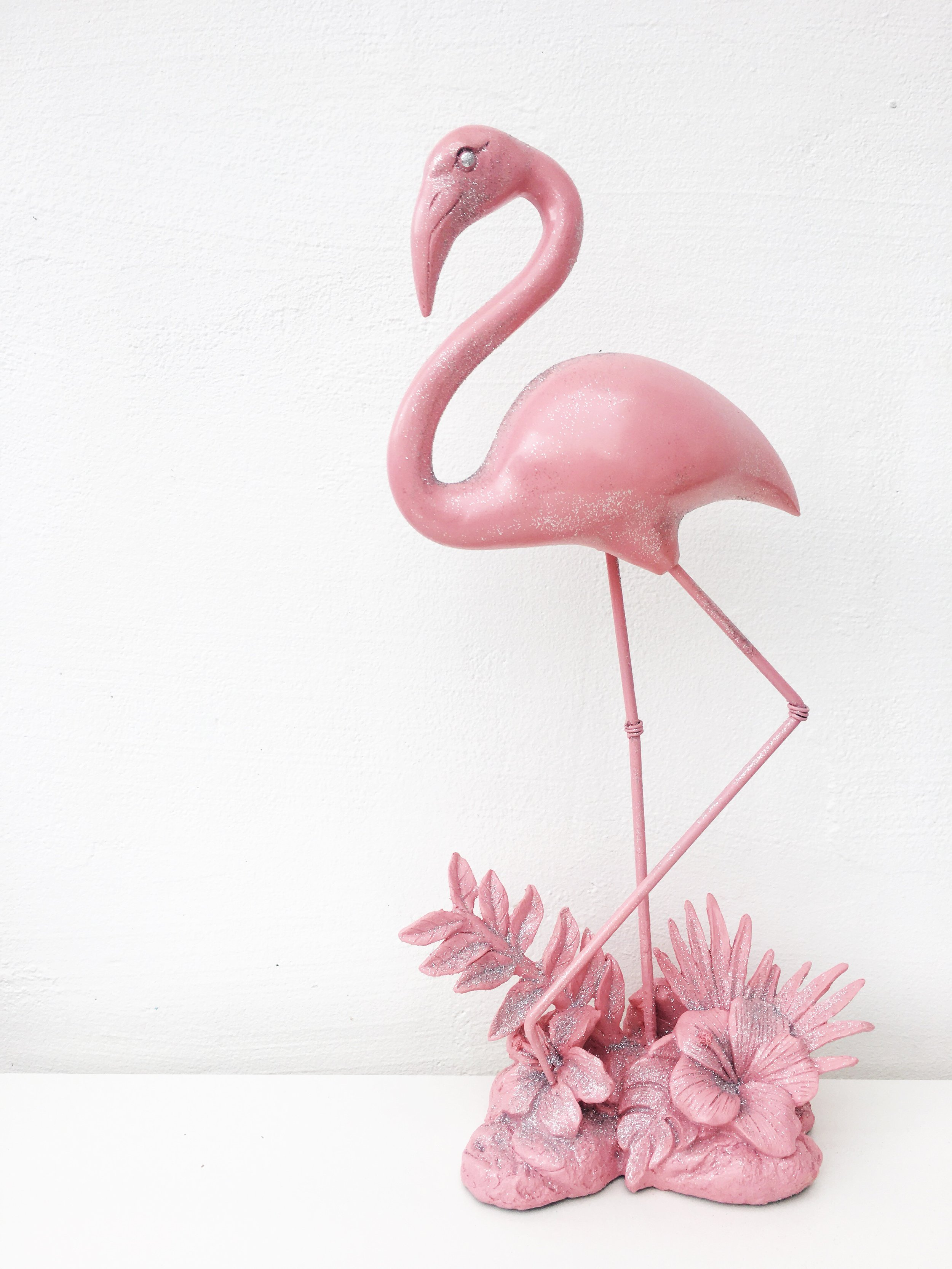 Fun metal painted decorative flamingo centrepieces with a hint of silver glitter. Three available to hire @ £9 each