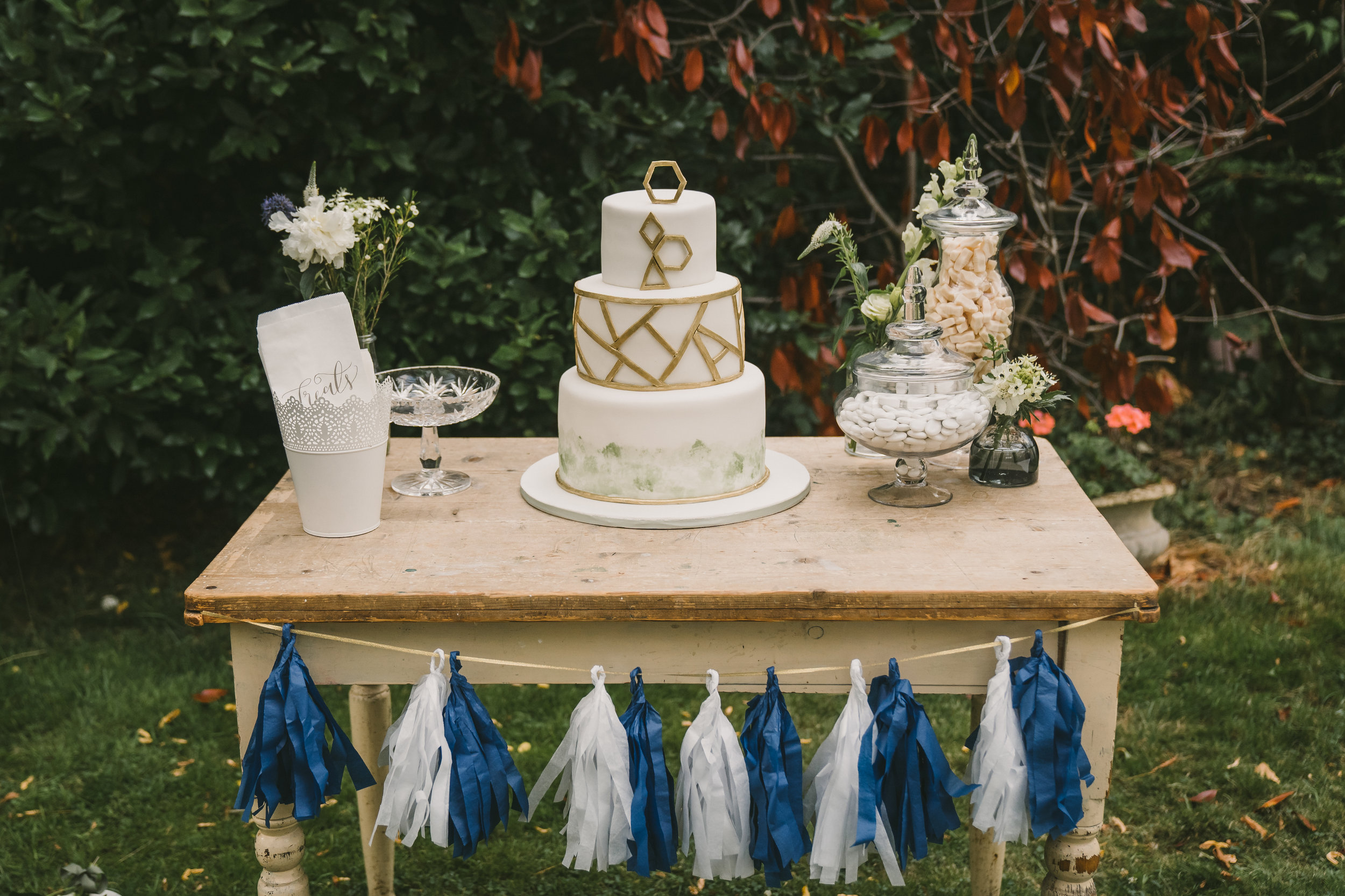 Vintage table for hire. One available £25. We can also create the tassel or ribbon garland
