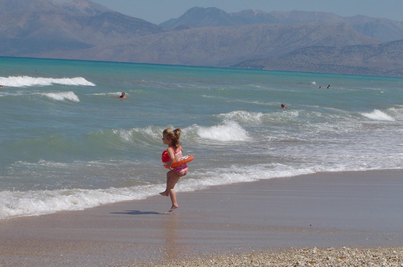 Acharavi beach girl skipping.jpg
