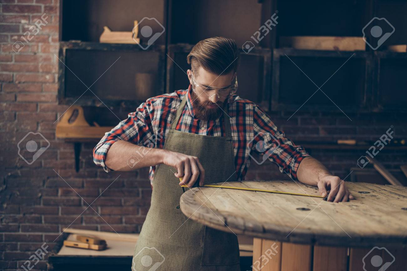 73096330-serious-handsome-craftsman-work-with-ruler-stylish-young-cabinet-maker-with-brutal-hairstyle-and-sav.jpg