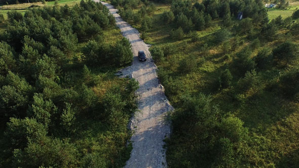 18_35_15_Aerial_Shot_of_Car_on_road_in_Forest.jpg