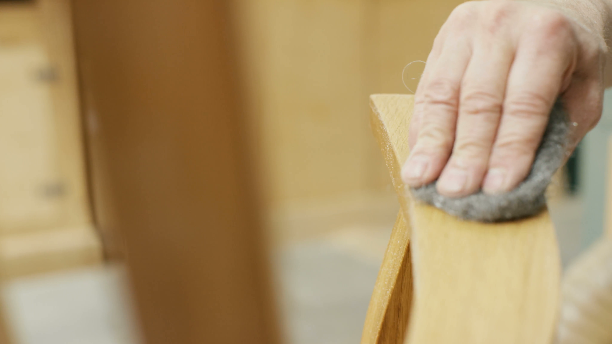 4k-close-up-on-the-hand-of-furniture-maker-in-his-workshop-putting-the-finishing-touches-to-a-rocking-chair-shot-on-red-epic_e7gfrfaskx__F0000.png