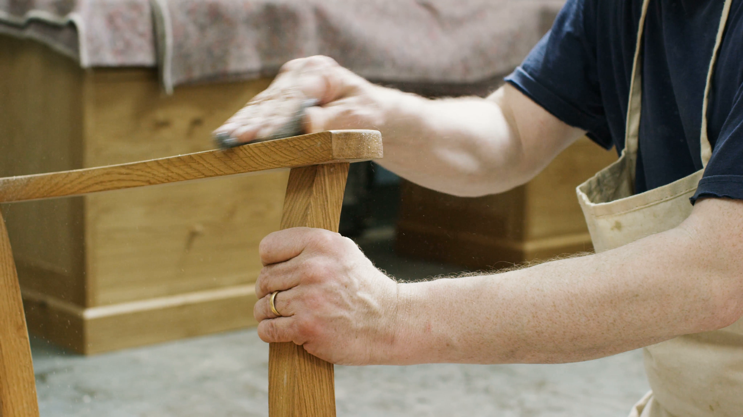4k-close-up-on-hands-of-furniture-maker-in-his-workshop-putting-the-finishing-touches-to-a-rocking-chair-shot-on-red-epic_e7qethhtx__F0000.png