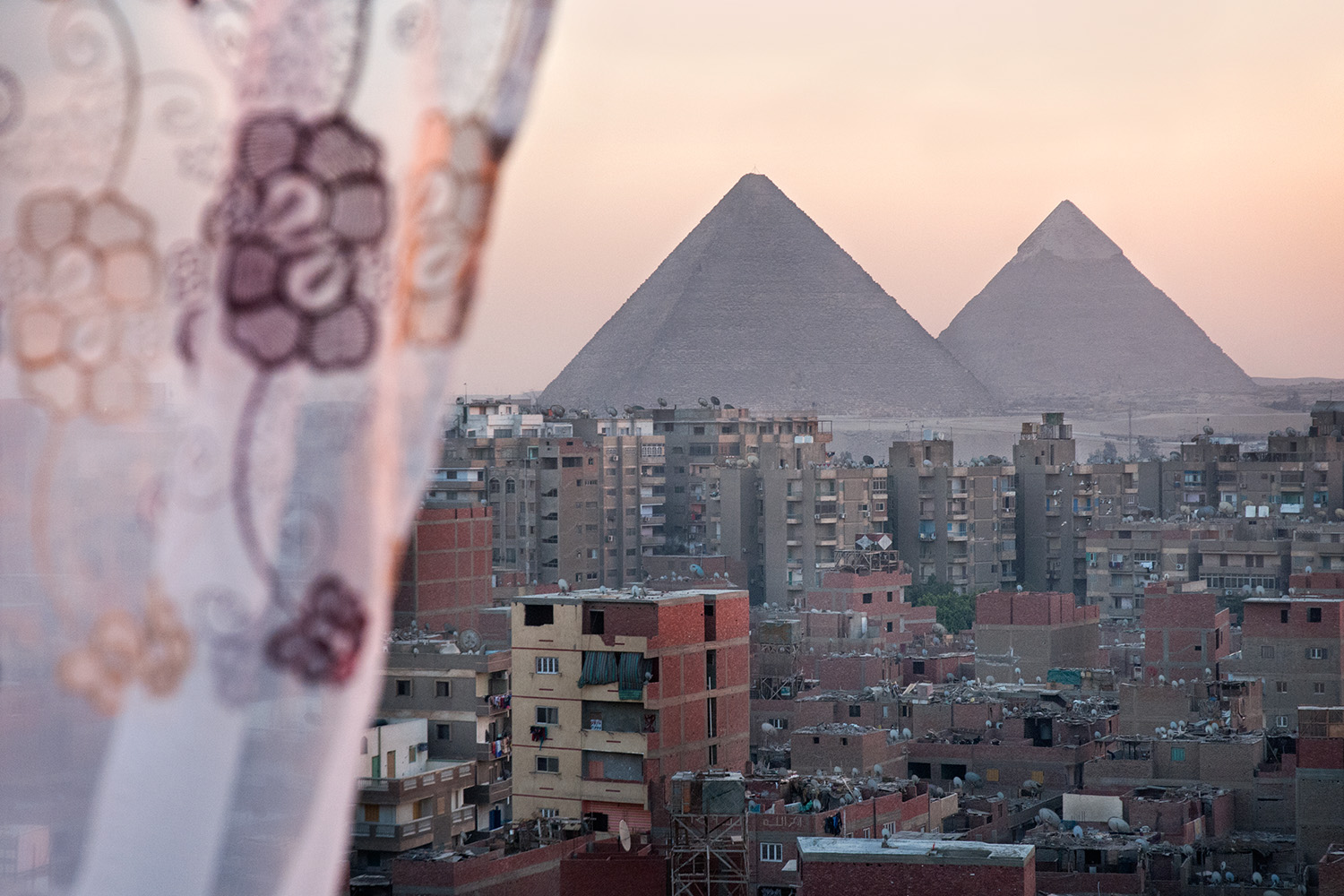 Cairo is a home place for around 20 millions of inhabitants. Nobody knows the exact number. Looking for livelihood and better living conditions Egyptians migrate to the capital and occupy every possible space: unfinished buildings, rooftops and even cementery.   Cairo Private is a journey through different Cairenes homes. Egyptians are very hospitable – they proudly invite one to their private spaces, always regale tea or food as well their life stories.   *  Excerpt. For full edit please contact: ania.egypt@gmail.com