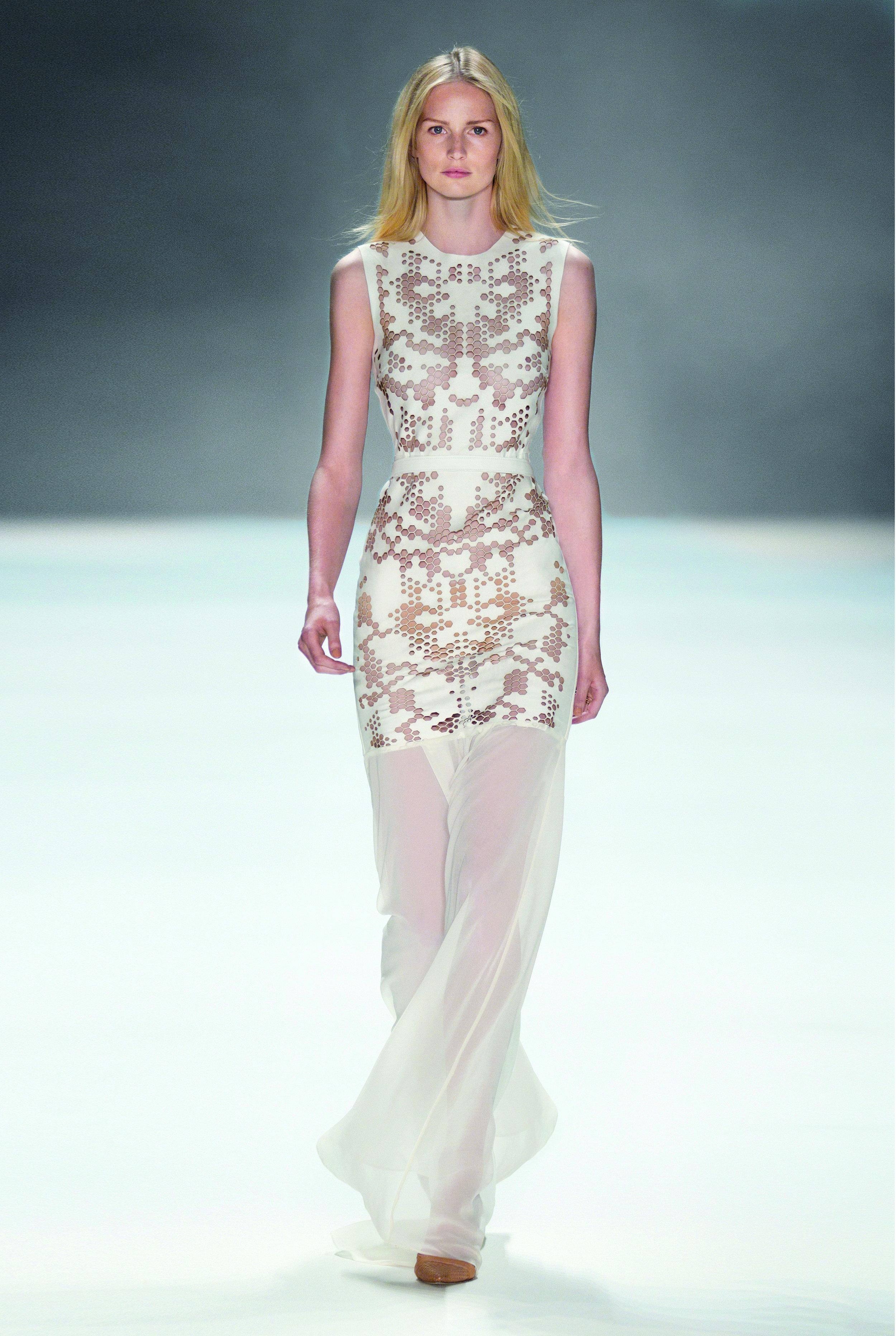 The crazy wedding dress with lasercut holes at Berlin Fashion Week 2013 ©Dan & Corina Lecca