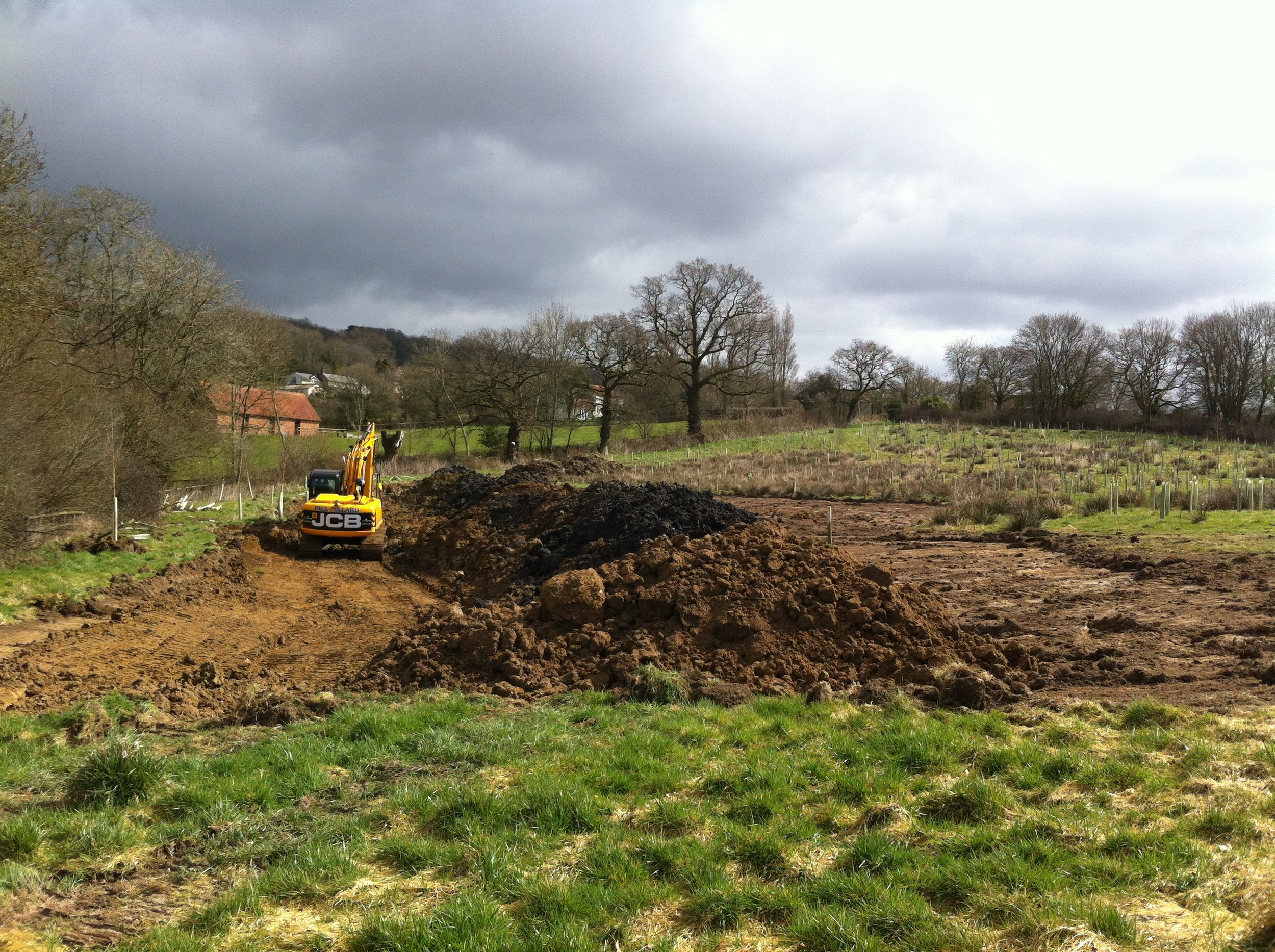 The pond being carved out of the land.....we started work in early spring 2015, construction was completed by mid-summer 2016 and it was full by January 2nd 2016.  This work, which took about 6 weeks, was done by Paul Millard Construction - Paul and Dan (the expert digger man) were amazing, bringing there expertise to this project...and look at the result.