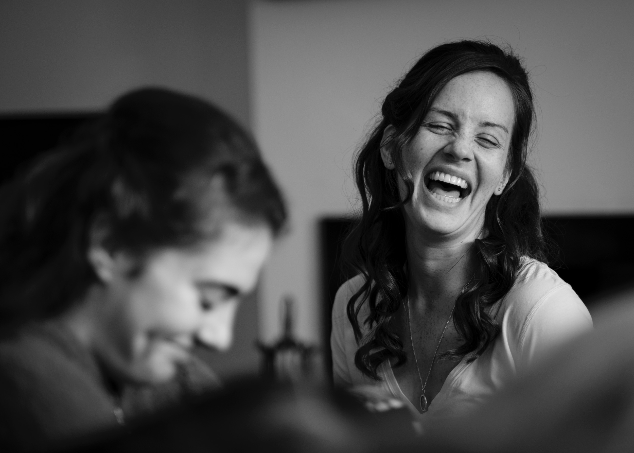 Wedding Photographer Rupert Marlow photo of Black and white wedding photography showing Laughing Bridesmaid