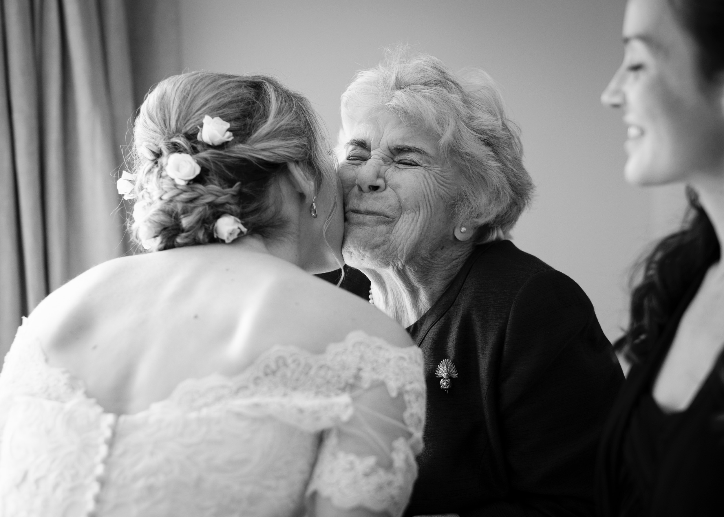Wedding photographer Rupert Marlow photograph of Emotional grandmother kissing the Bride on the morning of her wedding.
