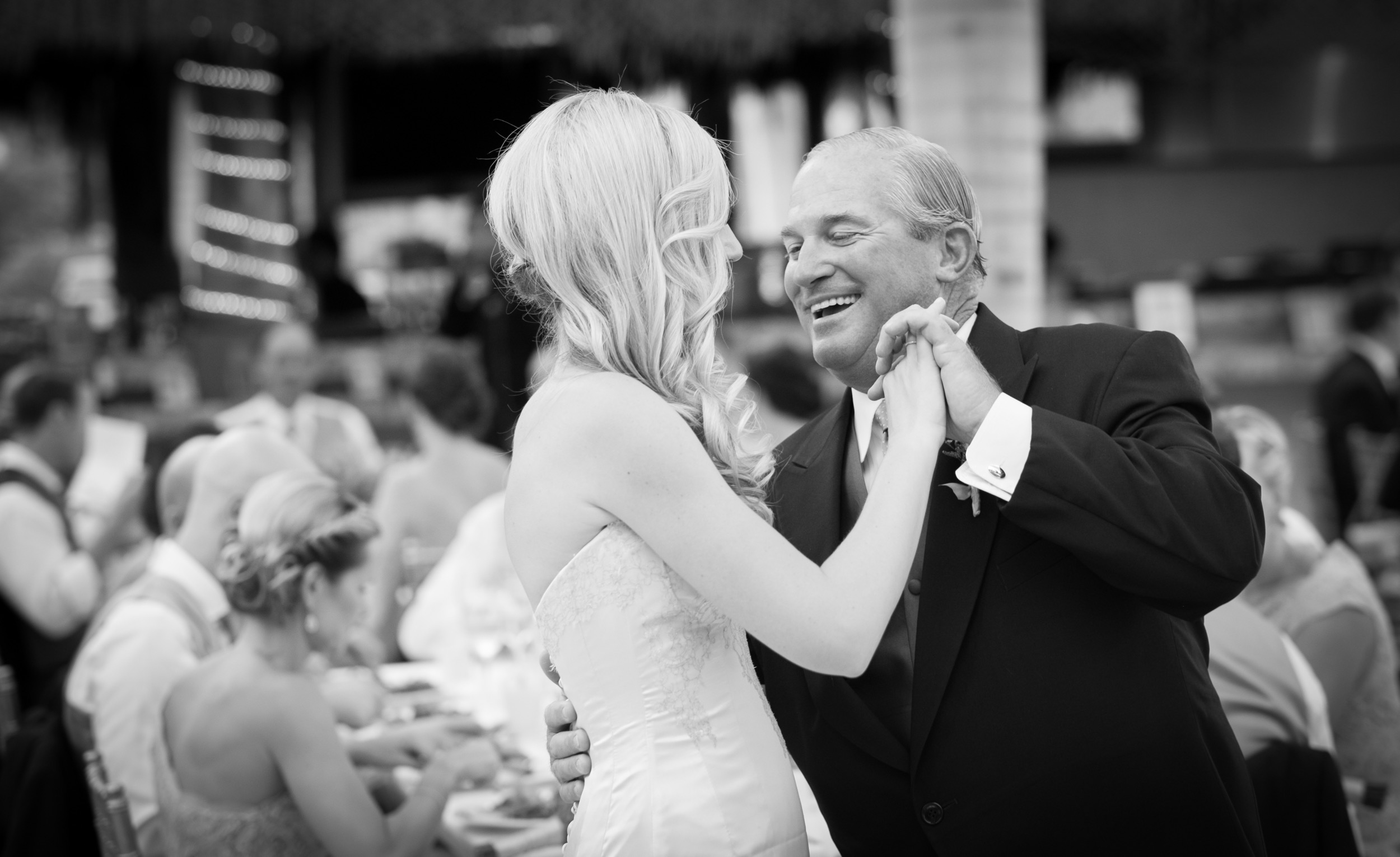 Proud father dancing with his daughter, the bride at a wedding in Mexico
