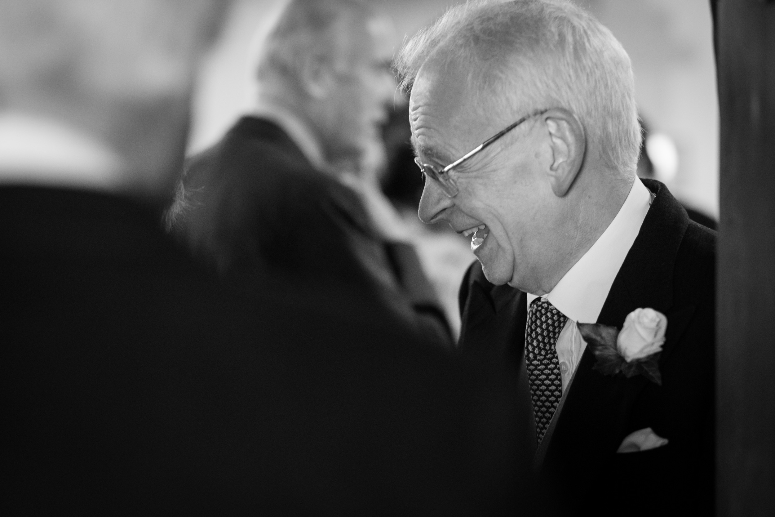 A side profile of a laughing man from a wedding in Gloucestershire