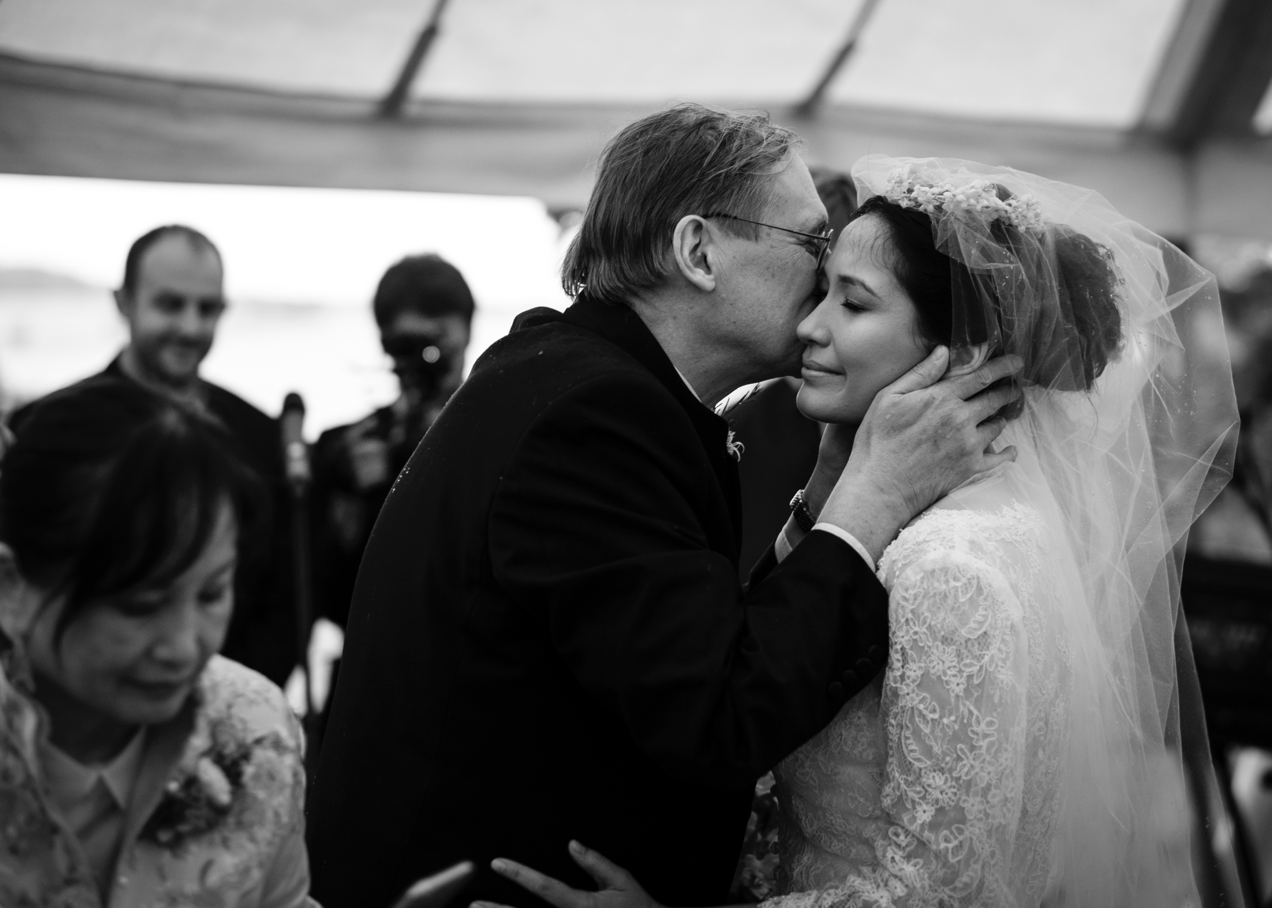 Wedding Photographer Rupert Marlow photograph of The father of the bride, kissing her on her wedding day in Gloucestershire