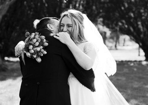 Rupert Marlow- Wedding Photographer bride hugging groom