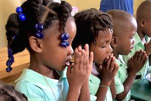 Row of children praying.jpg