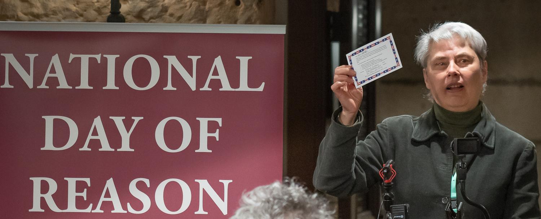 Audrey Kingstrom, HumanistsMN, urging people to send postcards to legislators in support of secular values