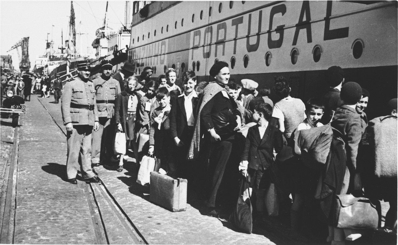 Refugee children in Lisbon boarding the ship that would also carry my grandmother to New York.