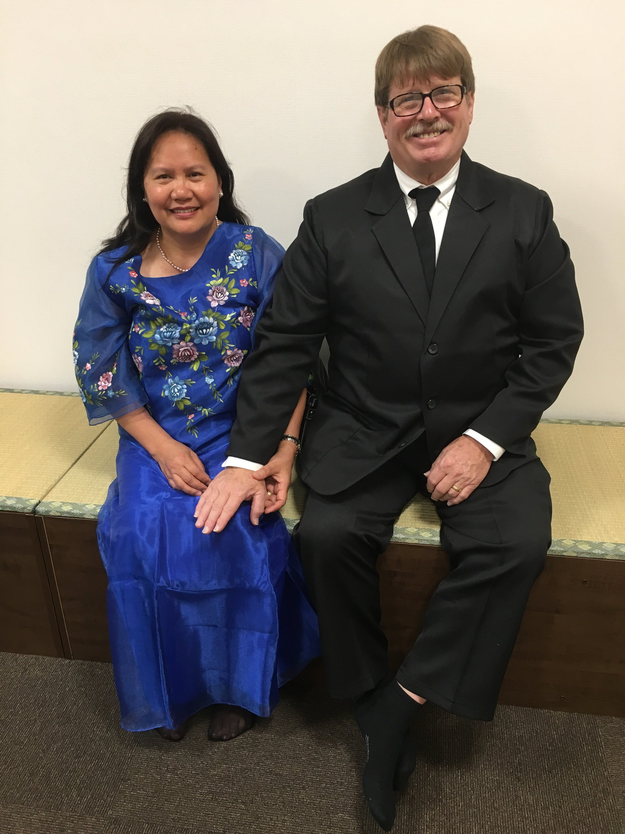 My parents at my brothers wedding- my mom is wearing the traditional formalwear of the Philippines.