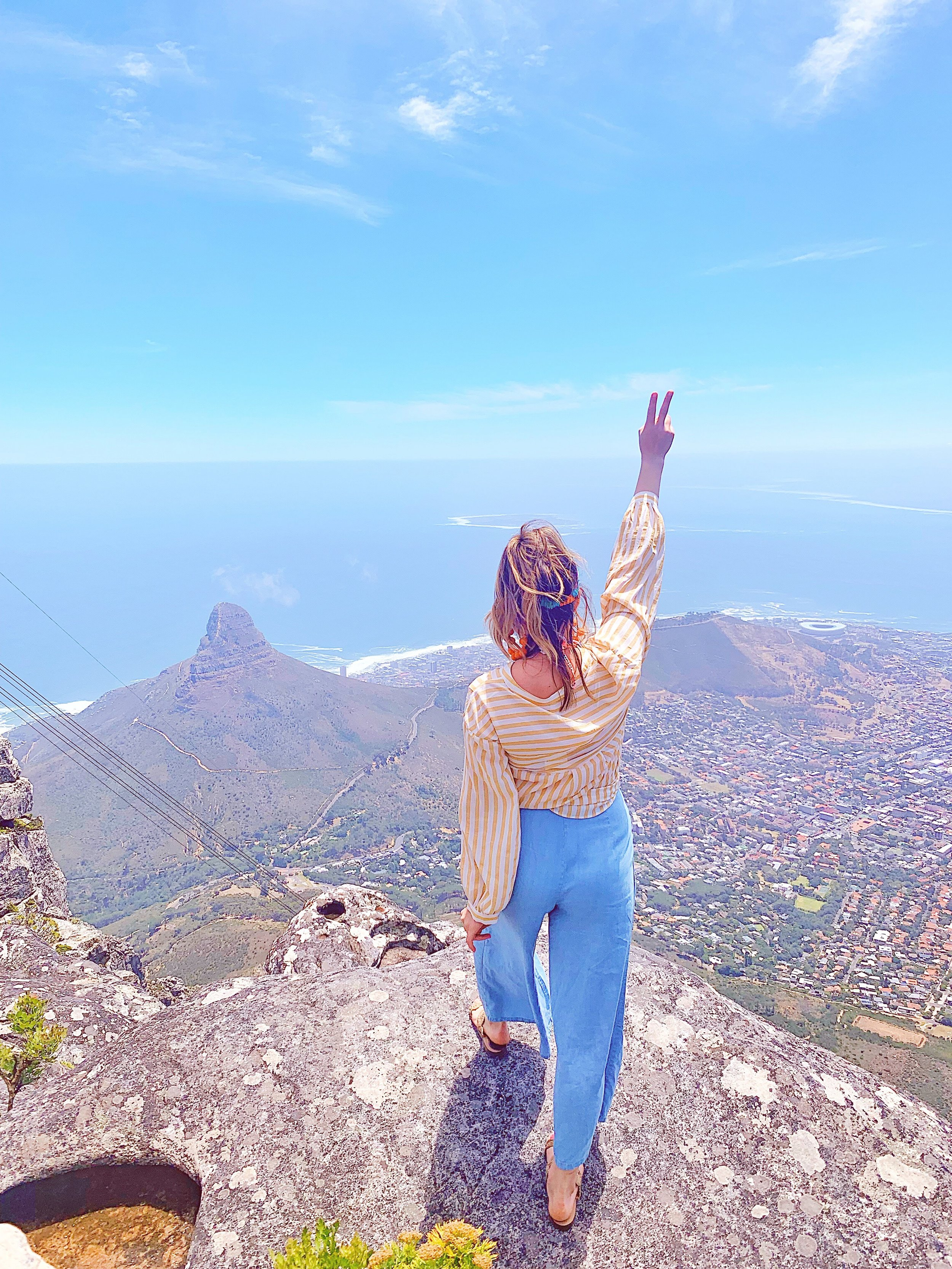 Incredible Views at Every Vantage Point - So the reason we went to Table Mountain twice is because the first time we went was so cloudy we couldn't see anything and we knew we were missing out. This time we were able to see everything and I'm so glad we ended up going again…I mean look at this photo! Luckily I'm not scared of heights so I'll do whatever I can (as long as it's semi-safe) for the gram.