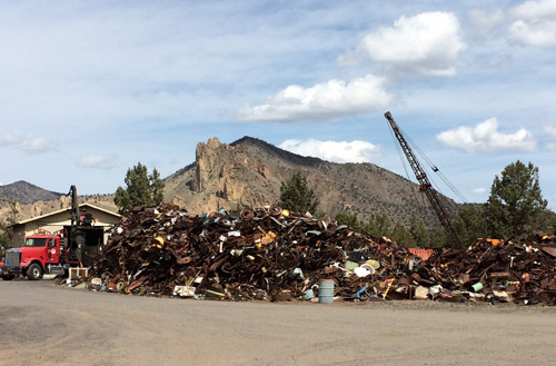 With Smith Rocks behind the salvage yard.