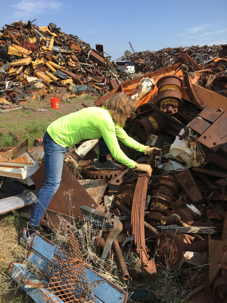 At the scrap yard! We are fortunate to have Swift & McCormick metal scrap in Terrabonne, not far from Bend. Rochelle hunting for treasures.