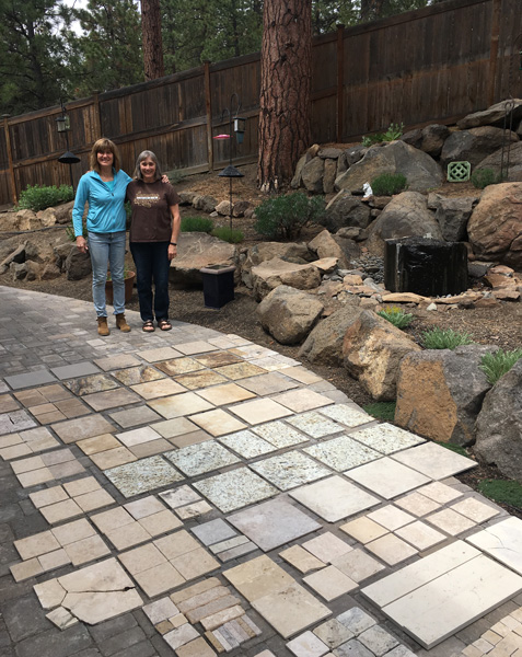 Look closely at the patio: we've laid out the travertine, marble and tile that we collected. Mostly for the Habitat ReStore. This makes way in the budget to procure a bunch of Mexican smalti!