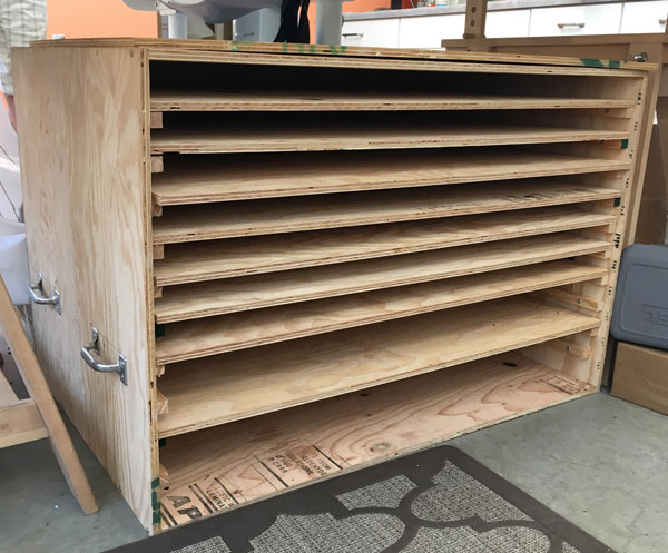 The first crate Rochelle constructed to transport the panels. The shelves come out to load and unload. A door will be attached, to seal for transport.