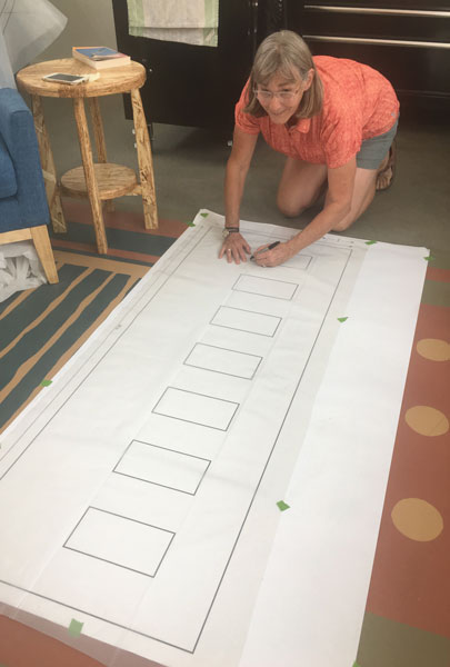 Me with the template to help us plan where the pergola beams will impact the top of our mosaic. Since we can't be sure the exact positions of the beams, in relation to the mosaic, we have to fabricate around the beams on site.