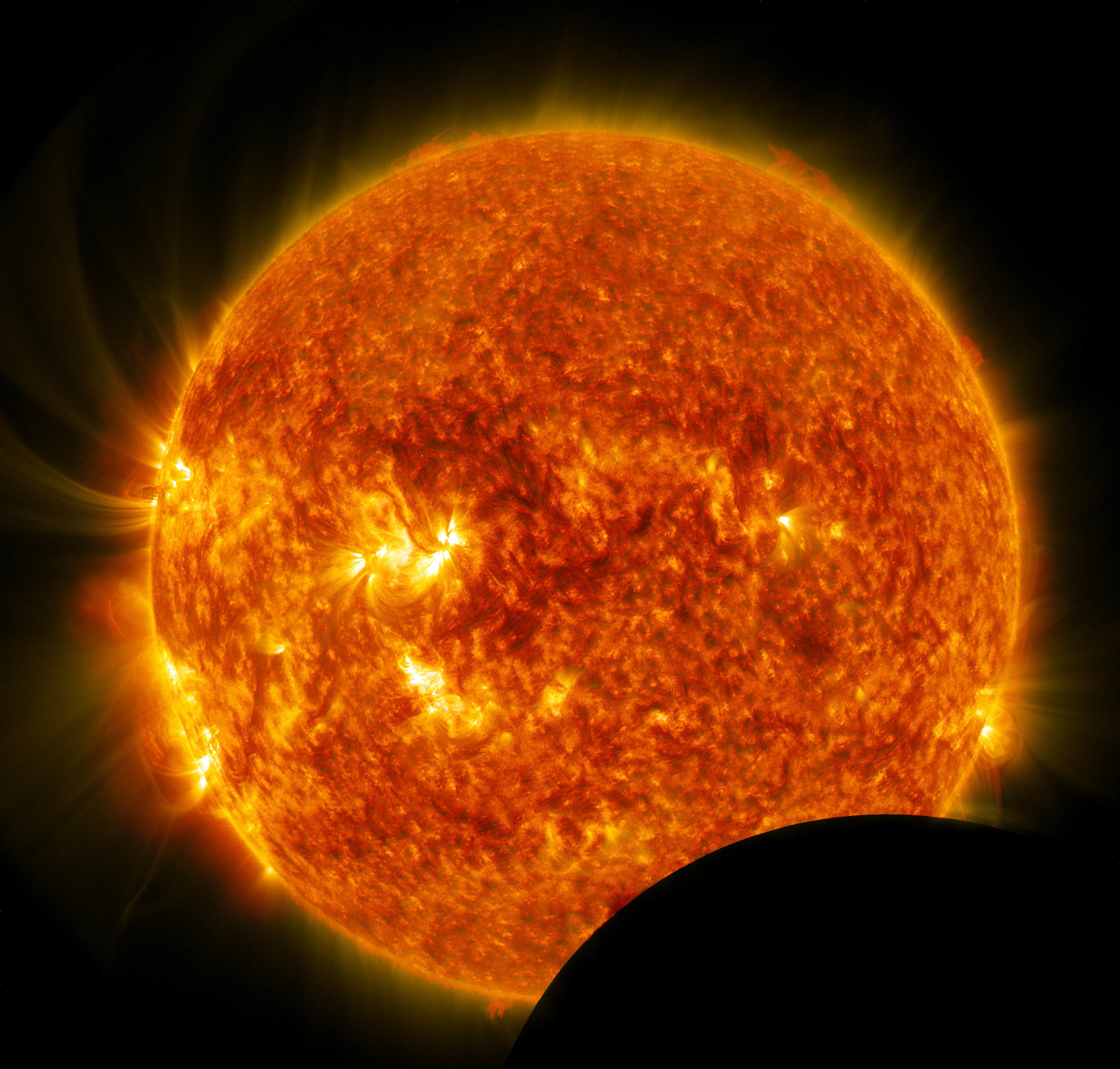 On July 26, 2014, from 10:57 a.m. to 11:42 a.m. EDT, the moon crossed between NASA's Solar Dynamics Observatory (SDO) and the sun, a phenomenon called a lunar transit. A lunar transit happens approximately twice a year, causing a partial solar eclipse that can only be seen from SDO's point of view. Images of the eclipse show a crisp lunar horizon, because the moon has no atmosphere that would distort light. This image shows the blended result of two SDO wavelengths - one in 304 wavelength and another in 171 wavelength. Image Credit: NASA/SDO
