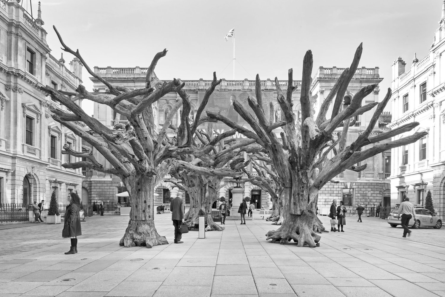 Ai Weiwei,  Tree , 2009–2010, tree sections and steel, dimensions variable. Installation view at Royal Academy of Art, London, 2015 © Ai Weiwei.