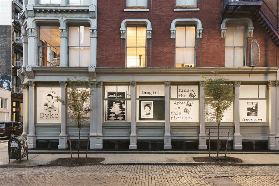 fierce pussy,   AND SO ARE YOU  ( ink on paper, site-specific window installation) , 1991-2018. Image courtesy the  Leslie-Lohman Museum.