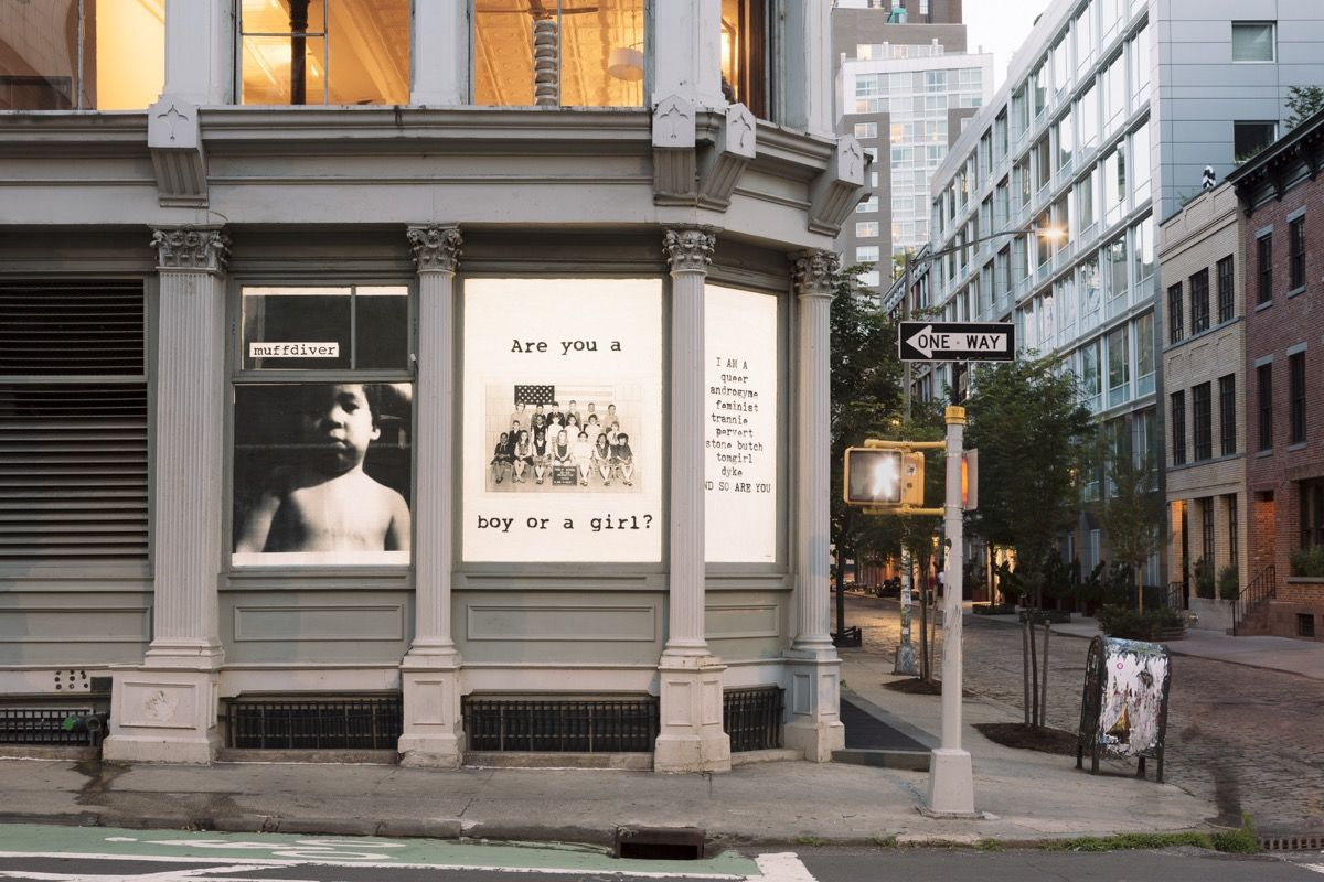 fierce pussy,   AND SO ARE YOU  ( ink on paper, site-specific window installation) , 1991-2018. Image courtesy  Kristine Eudey.